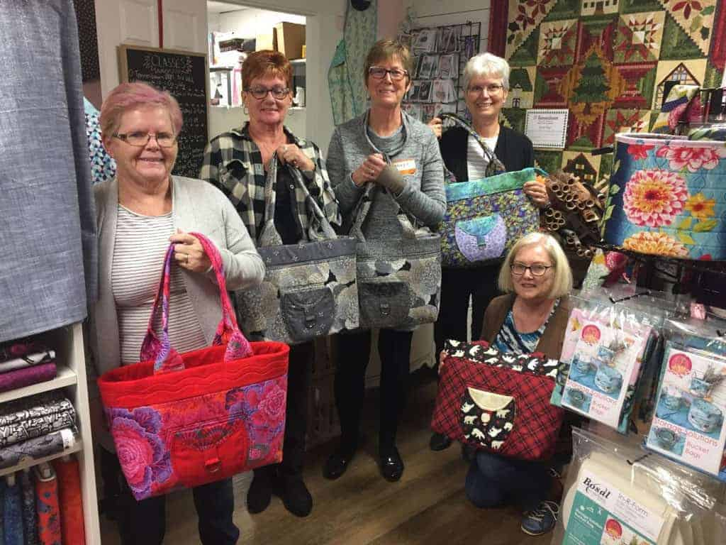 L to R, Linda Smith, Mary Winters, Mary Loupos, Debbie Pye Verhoven, Merle Vincent with Everything Goes Bags.